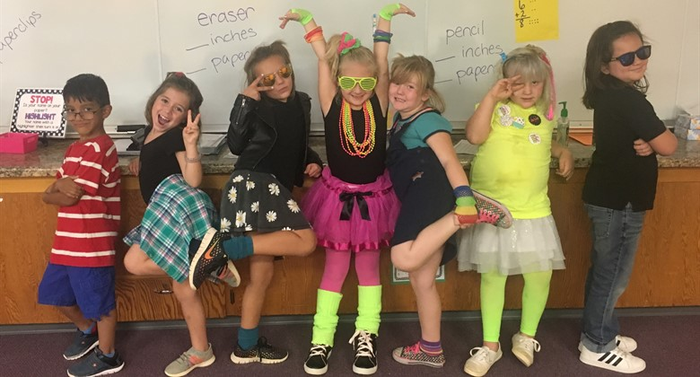 Elementary students are totally awesome showing spirit.