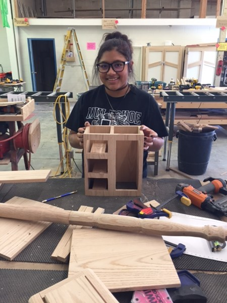 Various projects are created in woodshop class.