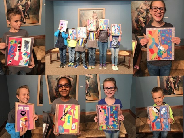 Gifted and Talented Students proudly display their art work from their field trip.